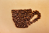 istock Scattered coffee beans frame design on copy space background. 1139973750