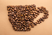 istock Scattered coffee beans frame design on copy space background. 1139973814
