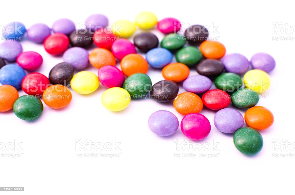 Scattered colored candy on a limited royalty-free stock photo