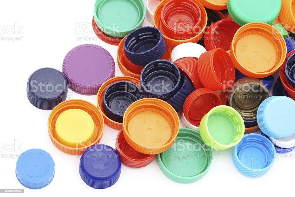 Scattered colorful plastic caps isolated in white stock photo