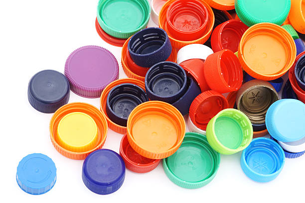 scattered colorful plastic caps isolated in white - plastic cap stock pictures, royalty-free photos & images