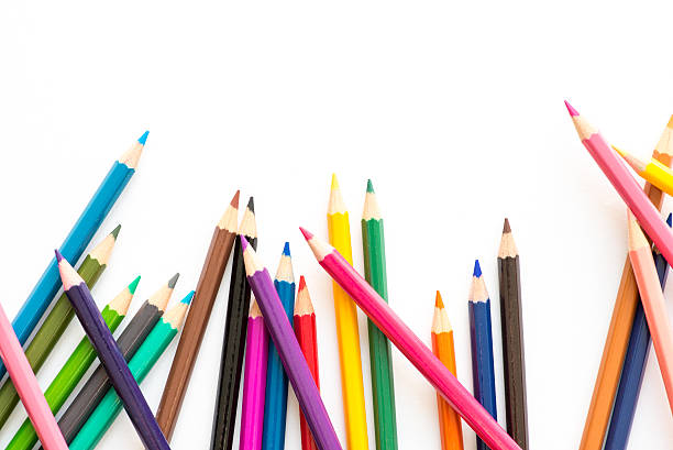 scattered coloring pencils - coloured pencil stock photos and pictures