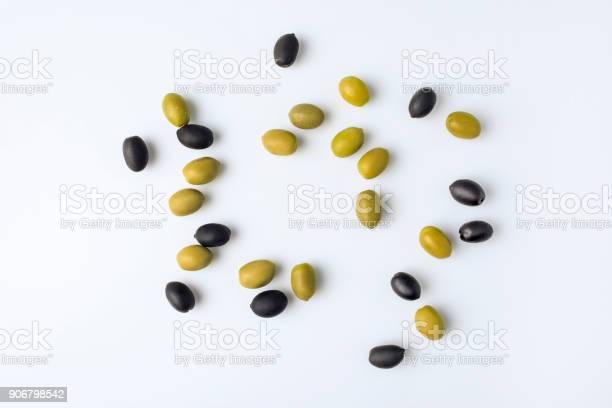 Scattered green and black olives picture id906798542?b=1&k=6&m=906798542&s=612x612&h=mt8t7fiqctak4karevdni0x7ivcmitjsjpv lccsxio=