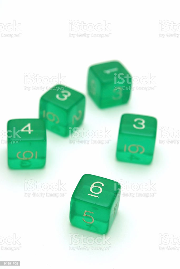 Scattered green dice. stock photo