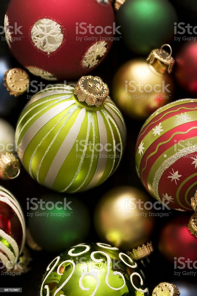 Scattered holiday bulb background of varied colors and sizes royalty-free stock photo