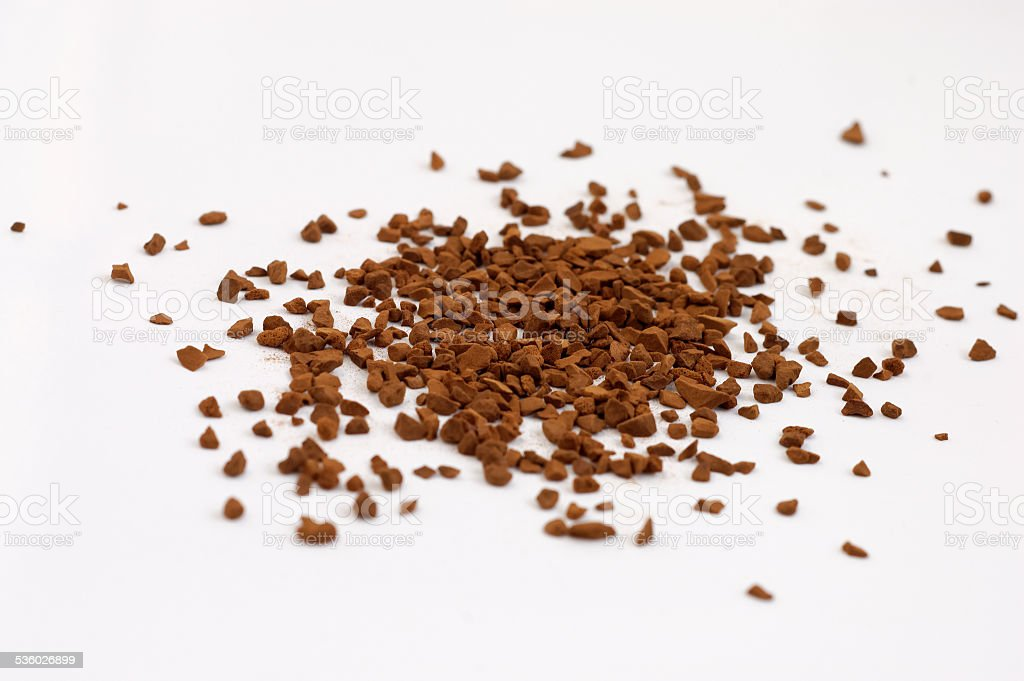Scattered instant coffee on a white background stock photo