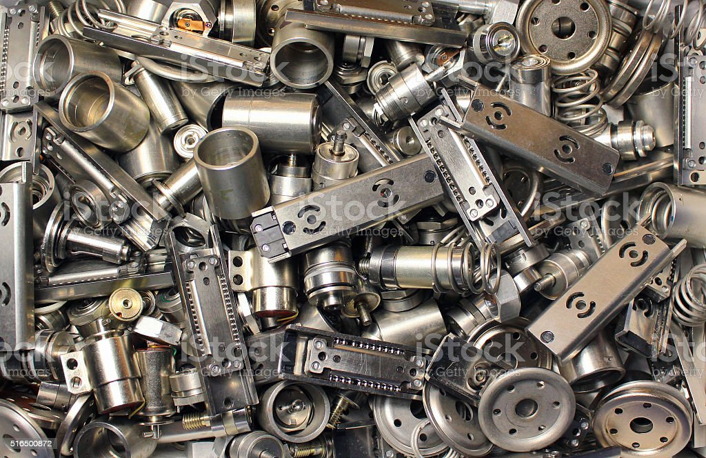 Scattered parts of old disassembled hard drives. stock photo