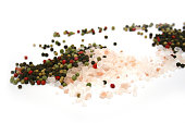 istock Scattered pile of Himalayan pink salt & mixed peppercorns 501645847