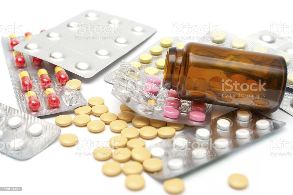 scattered pills stock photo