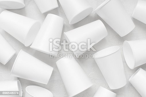 Scattered styrofoam empty cups on the white textured table