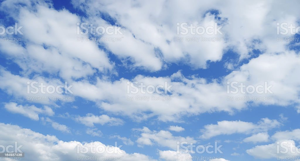 scattered white clouds royalty-free stock photo