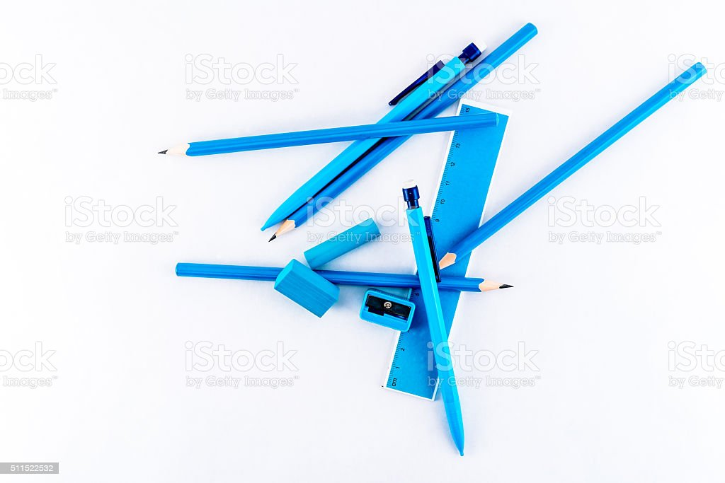 Scattered writing equipment, blue isolated on white background. royalty-free stock photo