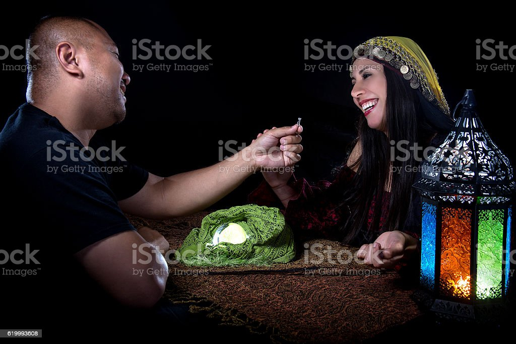 Scenario of male client proposing engagement to a female psychic stock photo