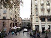 People walking in sidewalk of Rivadeneyra street. Bracelona, Spain