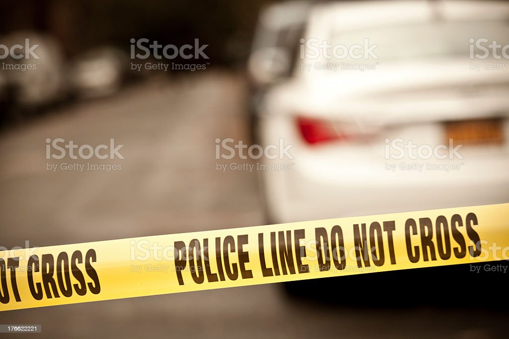A scene of a crime taped with a do not cross line  stock photo