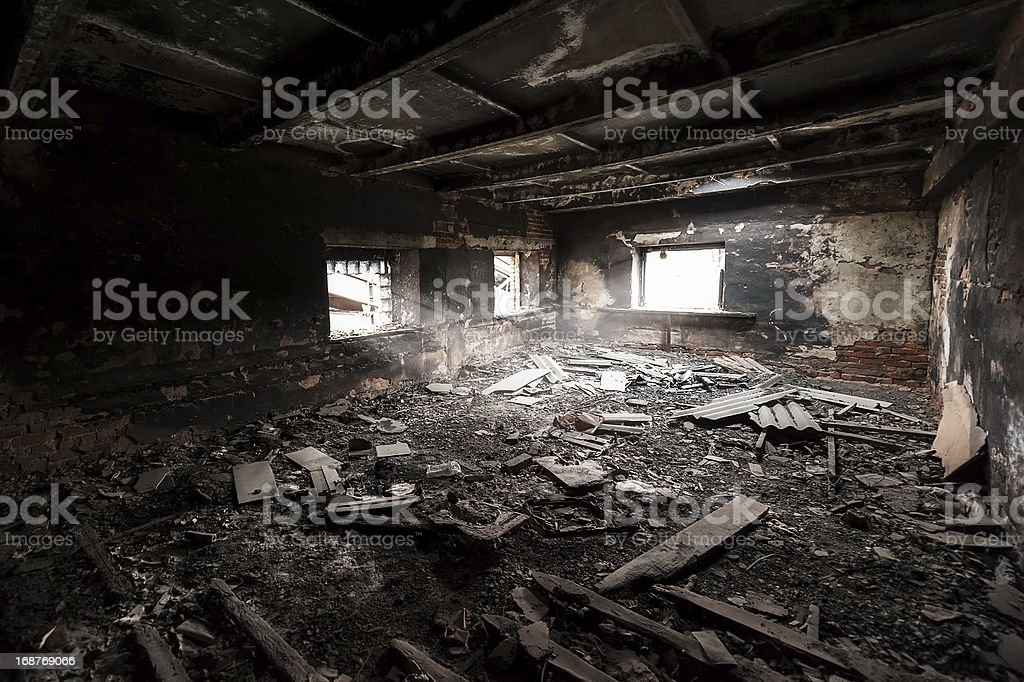 Scene of an abandoned and burned out room stock photo