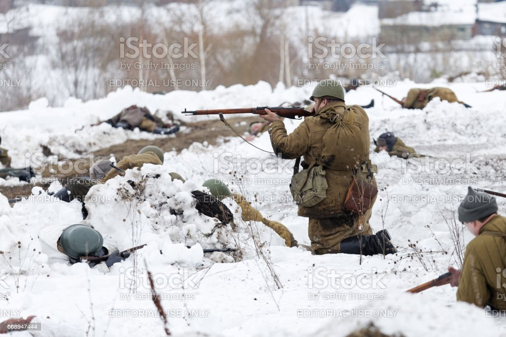 Scene of battle during military-historical festival 'Immortal feat' stock photo