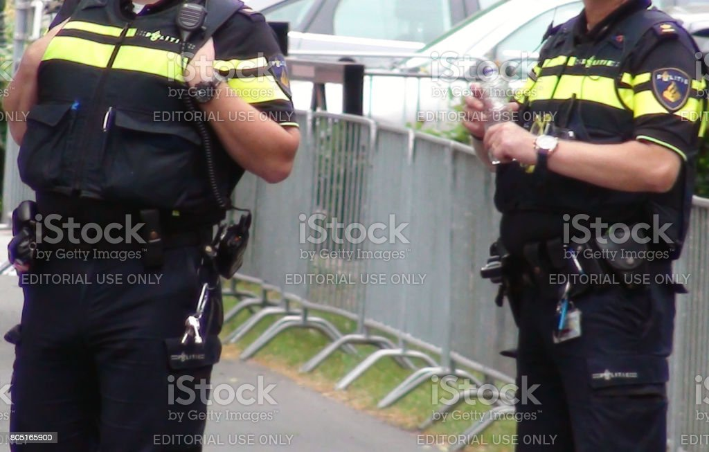 Scene Of Dutch Police Officers In Police Uniform Standing On The Street Of The Hague.South Holland.The Netherlands Europe stock photo