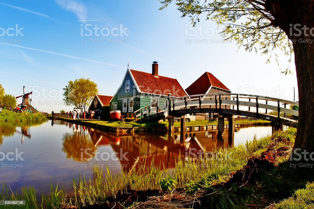 Scene of Dutch village, Windmill and Cottage, in Zaanse Schans stock photo