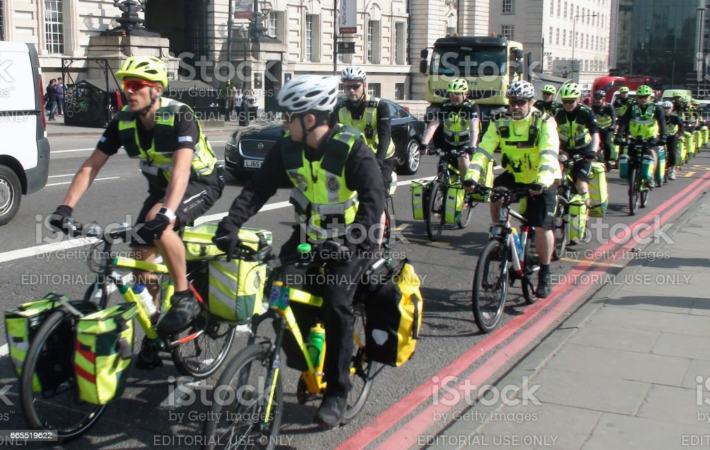 Scene Of London Ambulance Paramedics Crews On The Road With Bicycle In London.England.Europe stock photo