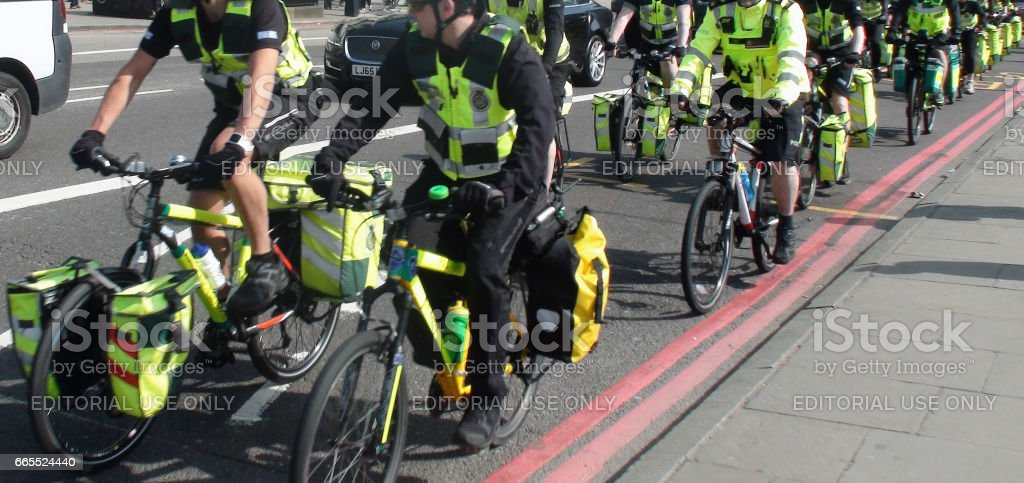 Scene Of London Ambulance Paramedics Crews On The Road With Bicycle In London stock photo