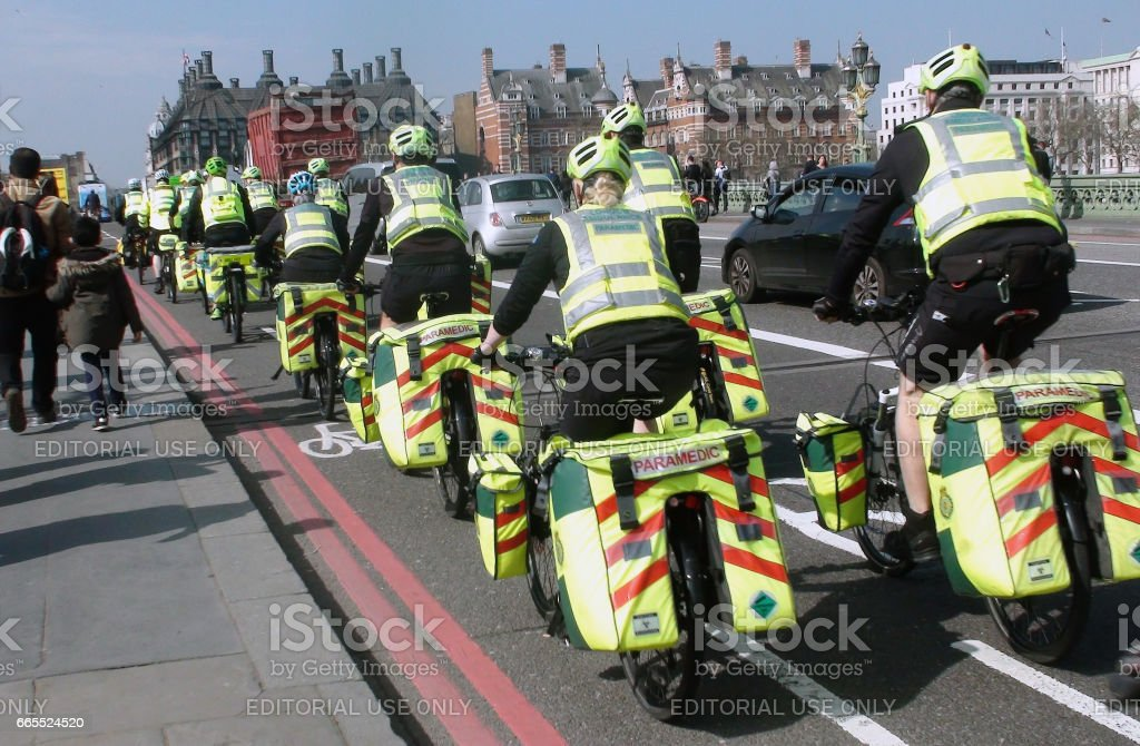 Scene Of London Ambulance Paramedics Crews On The Road With Bicycle In London.England stock photo