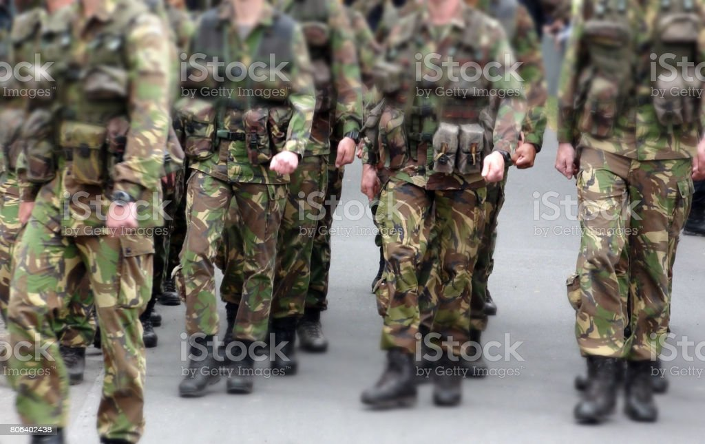 Scene Of Military Personnel Marching On The Street stock photo