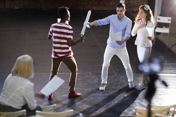 Scene of sword fighting Two young princes fighting with paper swords for heart of princess during stage repetition theatrical performance stock pictures, royalty-free photos & images