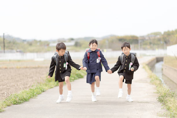 A scene where a Japanese elementary school student carries a school bag. stock photo