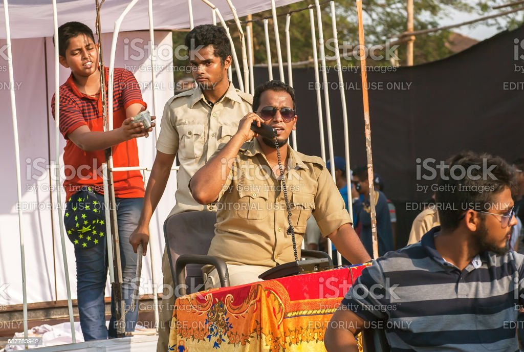 Scene with actors in policemen uniform playing corruption police department at traditional Goa carnival stock photo
