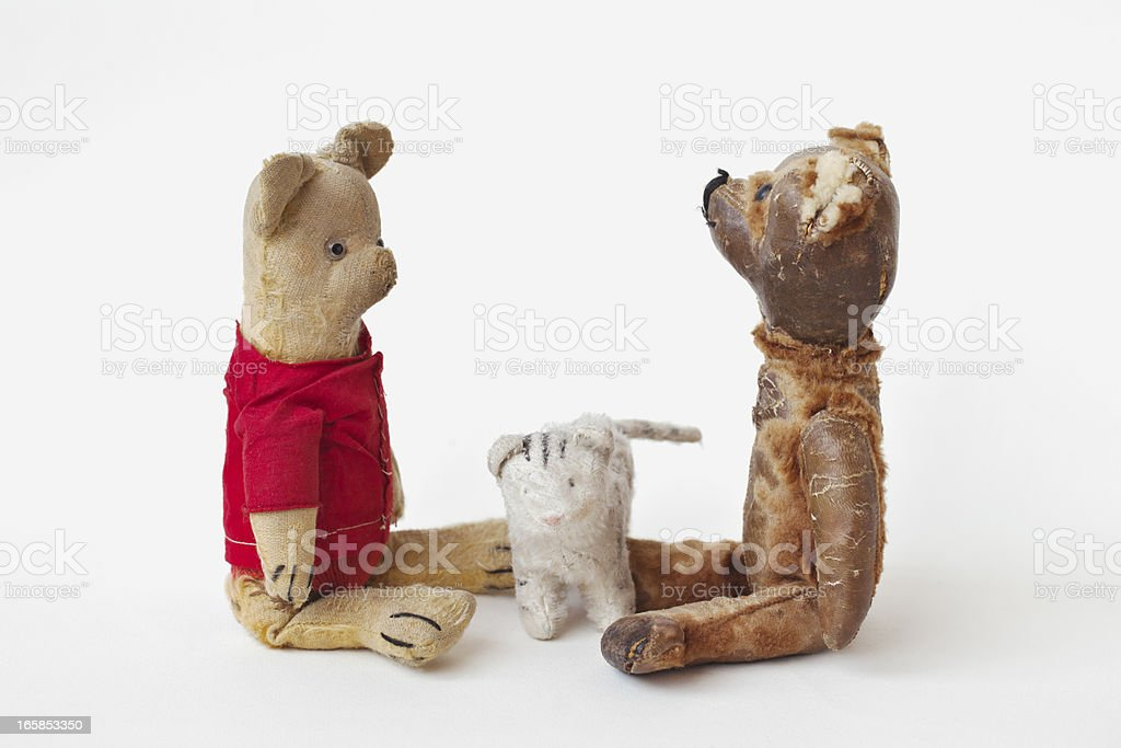 Scene with two vintage teddy bears and toy cat. royalty-free stock photo