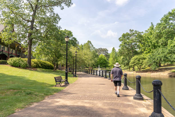 Scenery in Cleveland Park in upstate S.C. Spartanburg, S.C. / USA - May 4, 2019: A young man explores the beautiful Cleveland Park, a newly rebuilt park in Spartanburg County. spartanburg stock pictures, royalty-free photos & images
