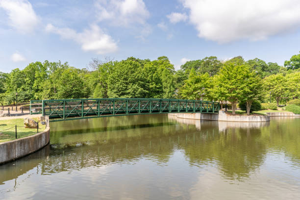 Scenery in Cleveland Park in upstate S.C. Inman, S.C. / USA - May 4, 2019: The beautiful bridge in Cleveland Park, a newly rebuilt public space in Spartanburg county. spartanburg stock pictures, royalty-free photos & images