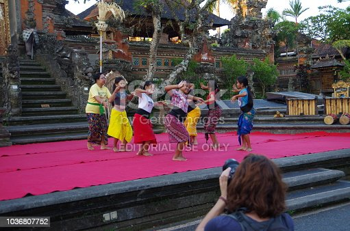 Ubud, Bali, Indonesia - April 29, 2018: It is the scenery of Bali, Ubud. This is in front of Ubud temple in Bali. The children are practicing dancing.It is a traditional Legong Dance. Everyone is worshiping the gods of Bali. Tradition is inherited.We can see it in the streets.Ubud is a very sacred place. You can hear Gamelan music from afar.