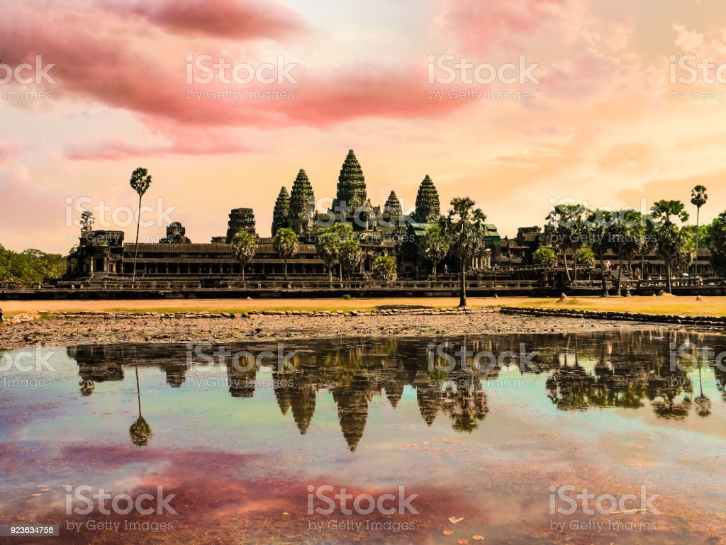 Scenery of Angkor Wat across the lake and the reflection in the water during sunrise. UNESCO world heritage site in Cambodia stock photo