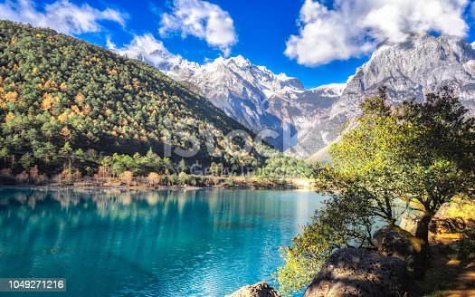 Scenery of Blue Moon Valley in Lijiang it is right beside the White Water River. The valley is of crescent shape and the water looks blue in sunny days.