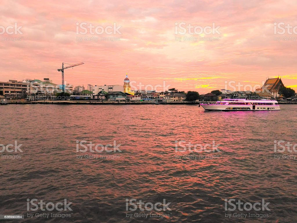 Scenery of boat tour and riverside buildings stock photo