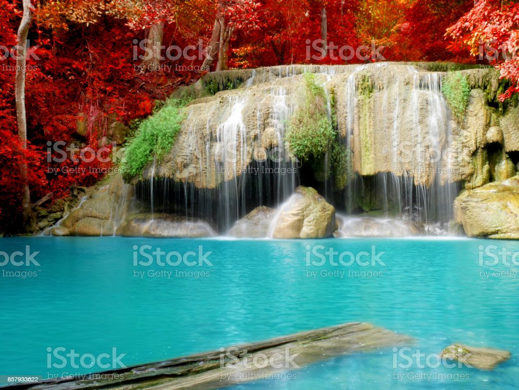 Scenery of colorful leaves and clear blue water in autumn stock photo