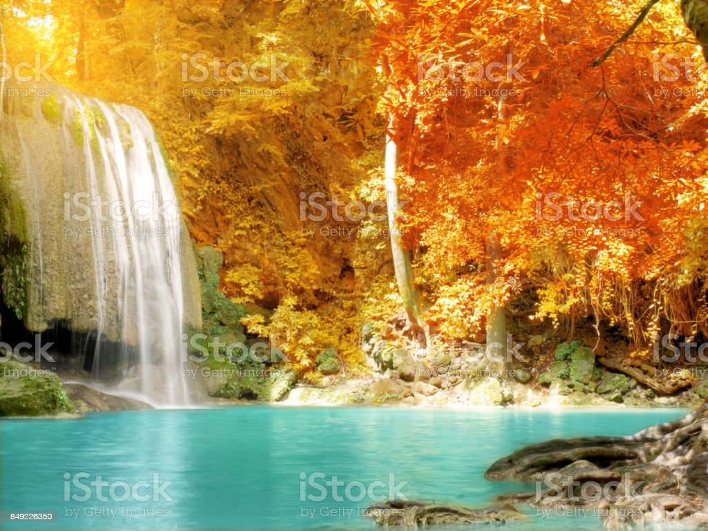 Scenery of colorful leaves and clear blue water stock photo