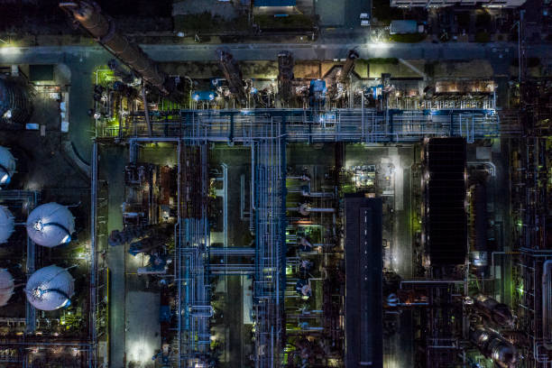 Scenery of factory at night during which lights are on stock photo