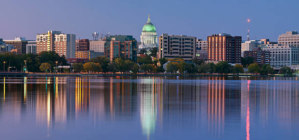 Scenery of Madison with a lake and tall office buildings Panoramic image of Madison (Wisconsin) at twilight. This is stitched composite of 5 vertical images. wisconsin stock pictures, royalty-free photos & images