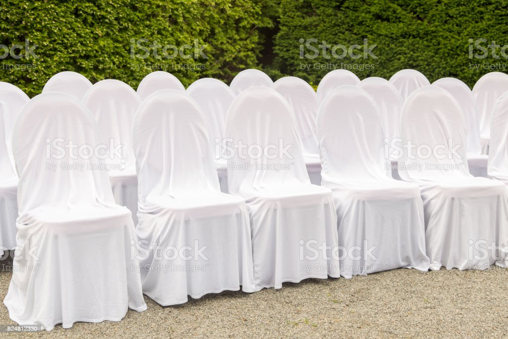 Scenery of the wedding ceremony in the park. White frame decorated...