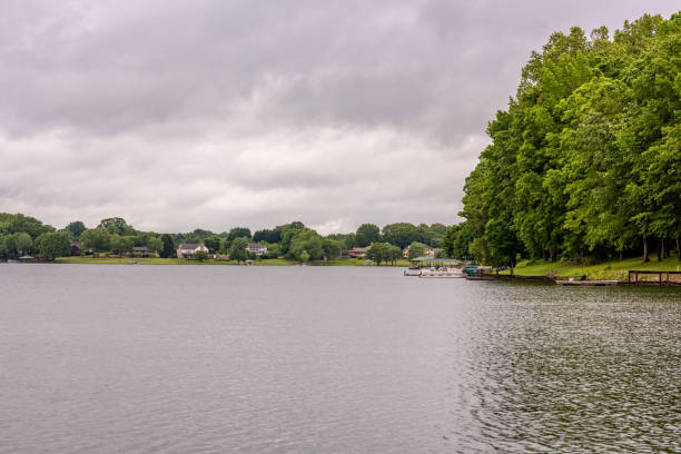 Scenery on a lake in upstate S.C. Inman, S.C. / USA - May 4, 2019: Beautiful, luxury homes on the banks of Lake Bowen, a man made reservoir in upstate South Carolina, in Spartanburg County. spartanburg stock pictures, royalty-free photos & images