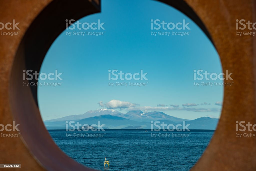 Scenery view of Tongariro national park view look through the sculpture decoration in Taupo town in North Island of New Zealand. stock photo