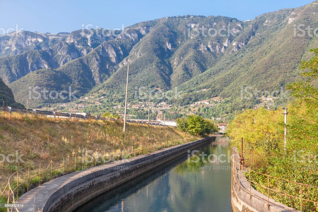 scenery with canal and mountains stock photo