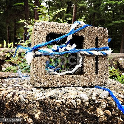 Scenes from Camp - Waterfront - Rope tied to cinder block