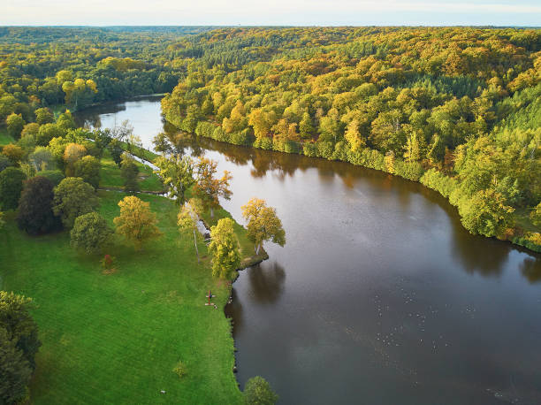 Scenic aerial view of a lake in autumn forest in northern France stock photo