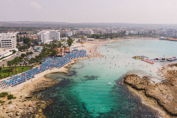 Scenic aerial view of beach with blue umbrellas on Cyprus stock photo
