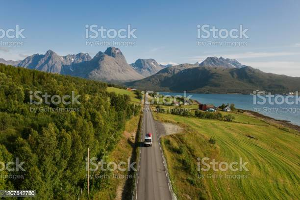 Photo of Scenic aerial view of camper van on  road in Norwegian countryside