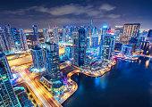 Scenic aerial view of Dubai Marina by night. United Arab Emirates. Colourful travel background.